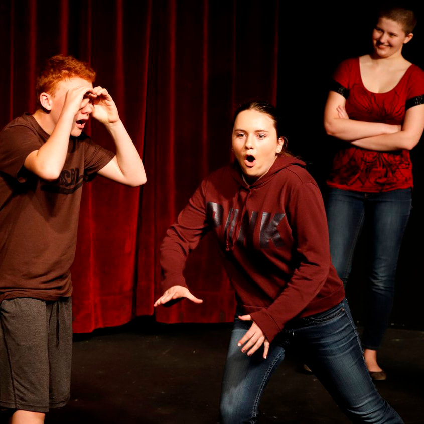Young teens during a rehearsal of improv theatre